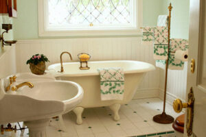 Bathroom with claw style tub and nice white tiles